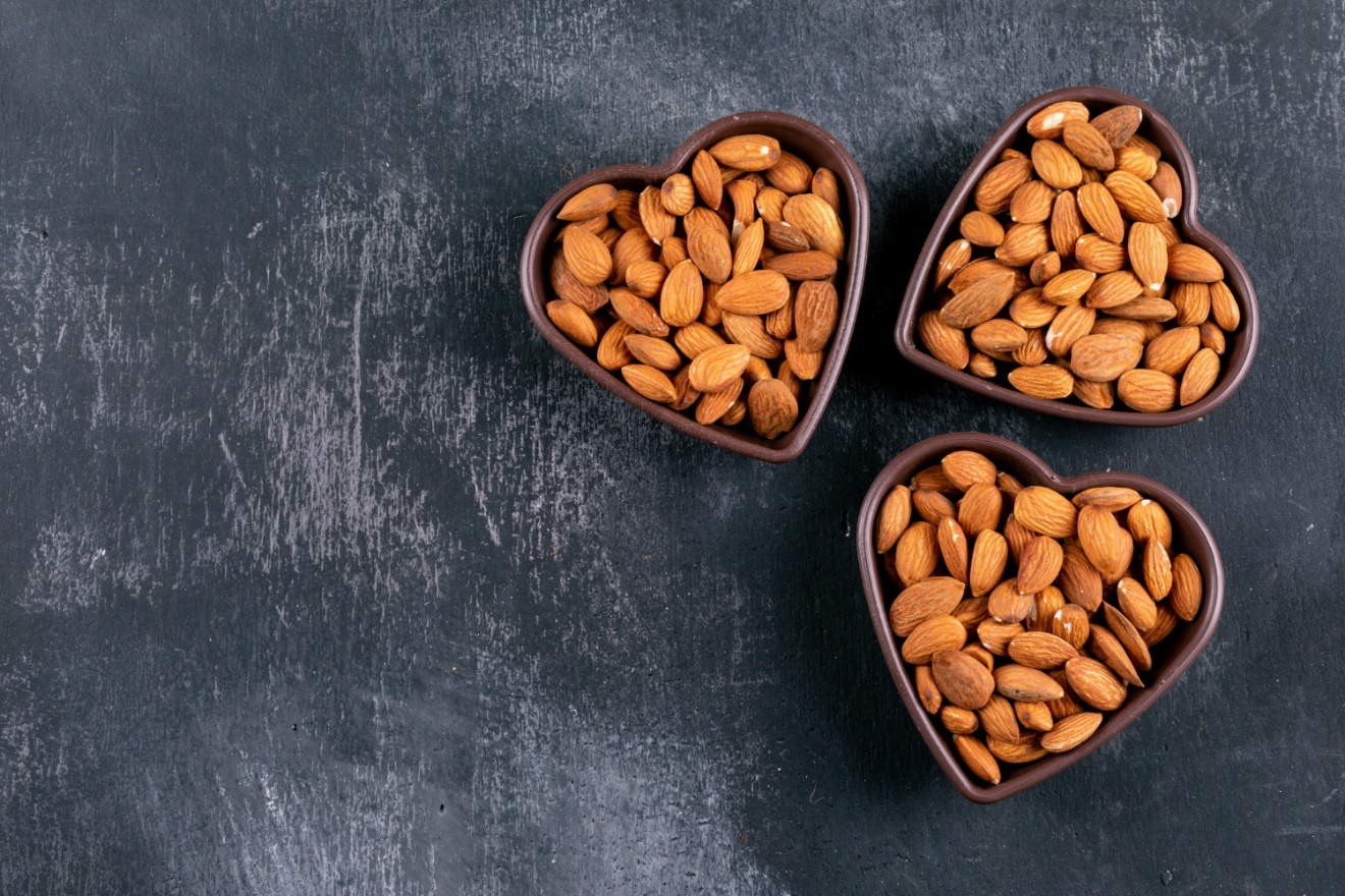 C:\Users\Dell\Downloads\almond-heart-shaped-bowls-black-stone-table-flat-lay.jpg