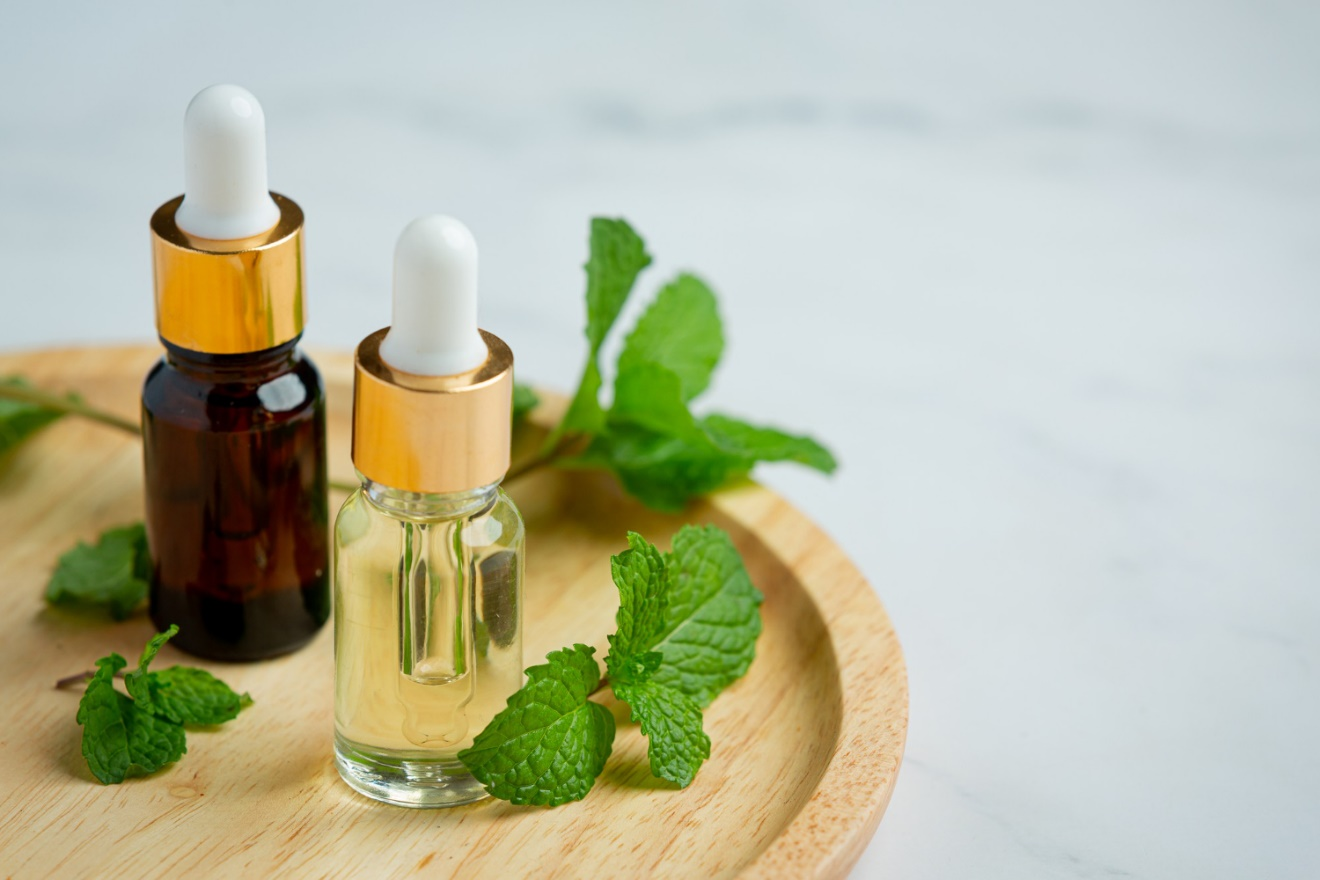 C:\Users\Dell\Downloads\essential-oil-peppermint-bottle-with-fresh-green-peppermint (1).jpg