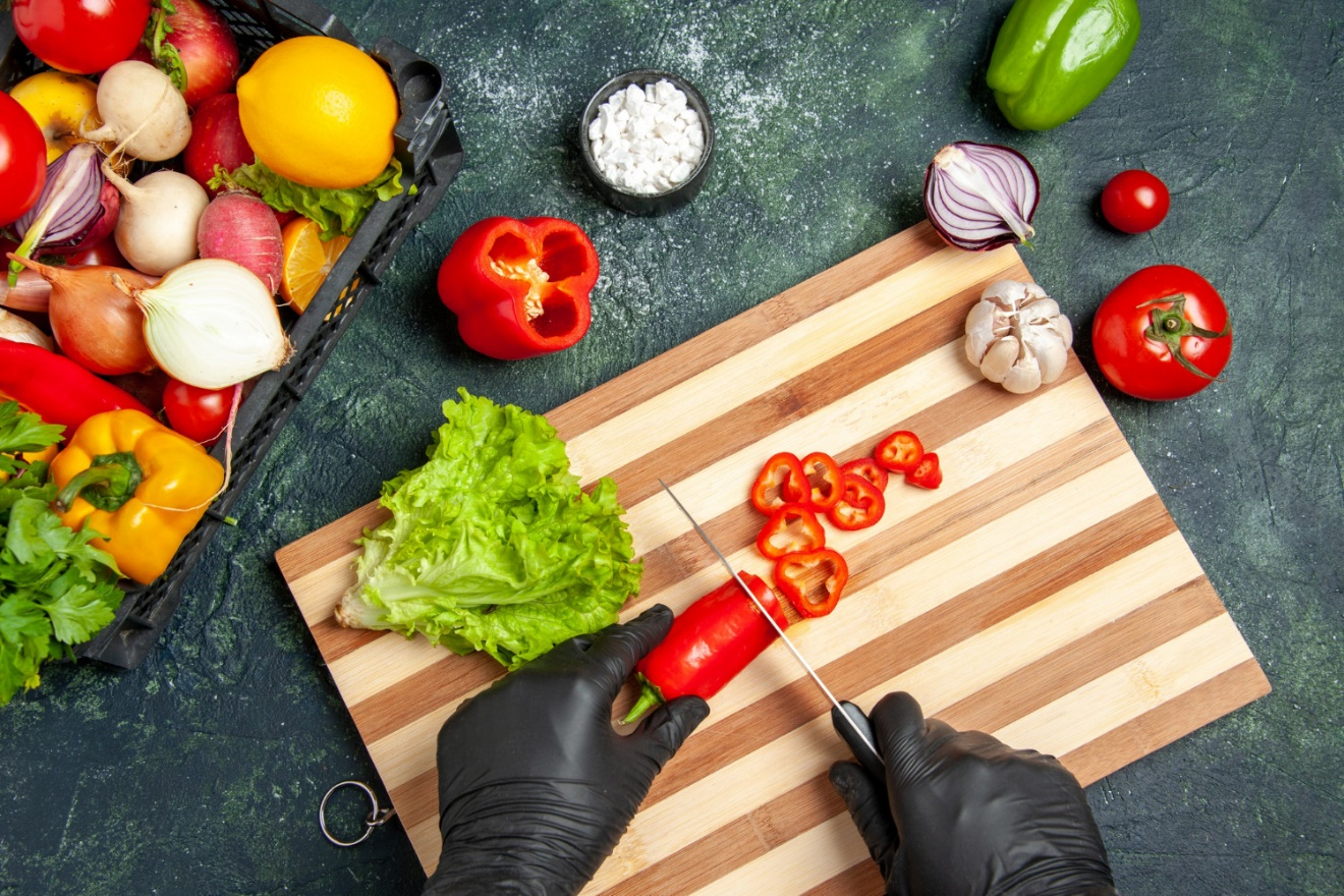 C:\Users\Dell\Downloads\top-view-female-cook-cutting-red-chilly-pepper-gray-surface.jpg