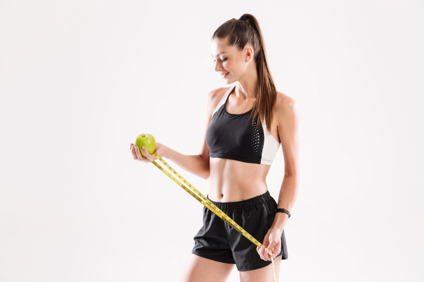 C:\Users\Dell\Downloads\portrait-happy-healthy-fitness-woman-holding-green-apple.jpg