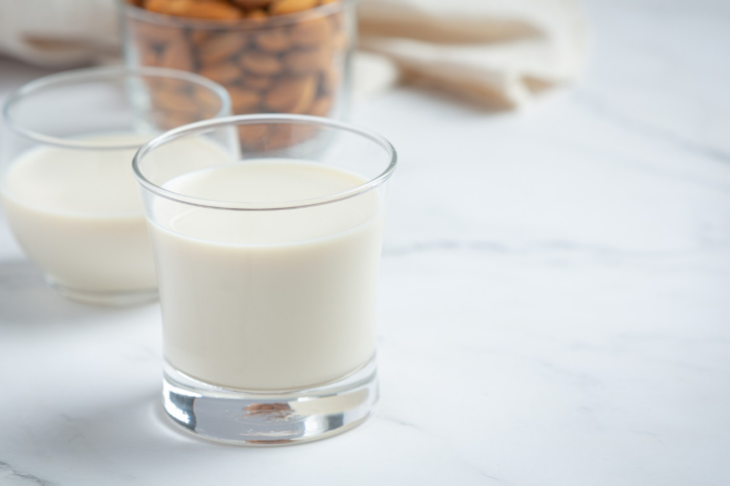 C:\Users\Muhammad Ismail\Downloads\almond-milk-with-almond-marble-background.jpg
