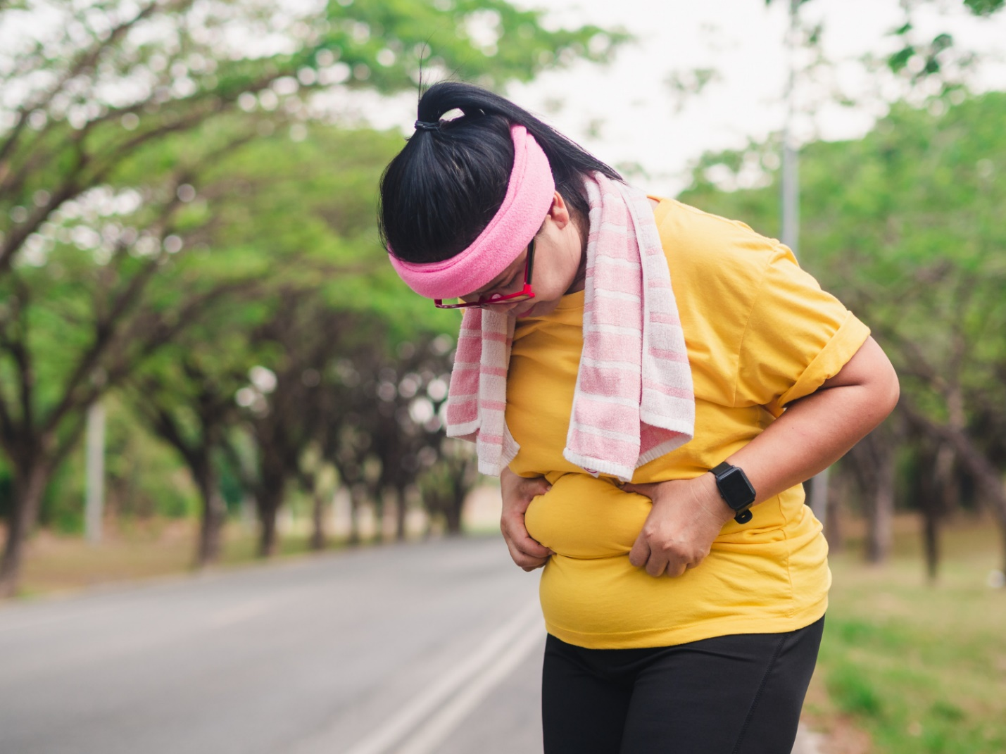 C:\Users\Dell\Downloads\overweight-woman-holding-her-belly-weight-loss-concept.jpg