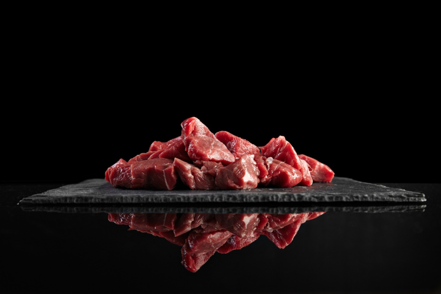 C:\Users\Dell\Downloads\pieces-raw-fresh-meat-isolated-black-stone-board-mirrored-side-view.jpg