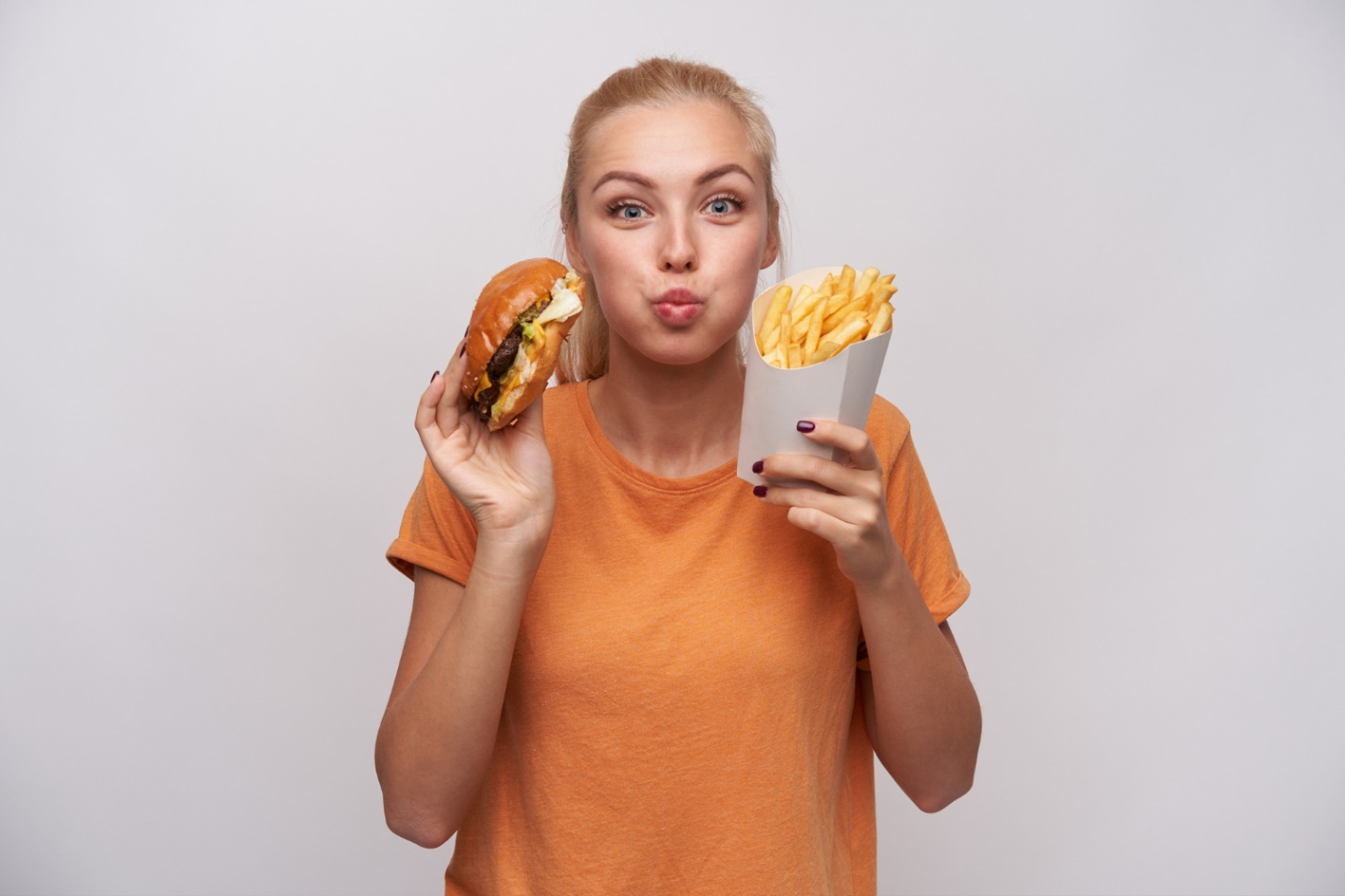 C:\Users\Dell\Downloads\portrait-charming-pretty-young-blonde-woman-holding-junk-food-looking-joyfully-camera-puffing-out-cheeks-being-excited-about-tasty-dinner-isolated-white-background.jpg