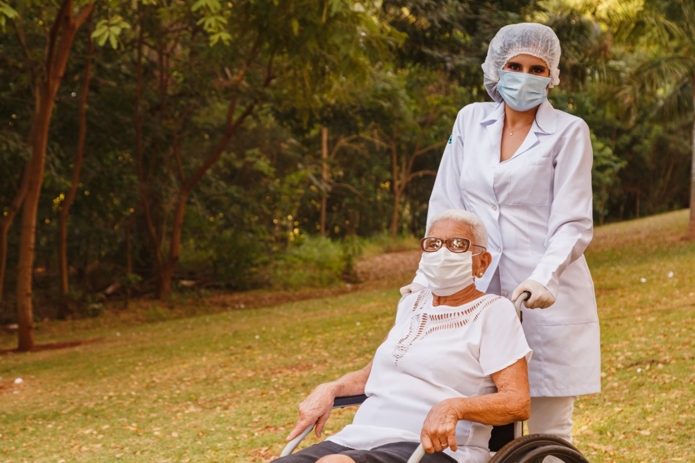 C:\Users\Dell\Downloads\senior-disabled-woman-with-caregiver-garden-nursing-home.jpg