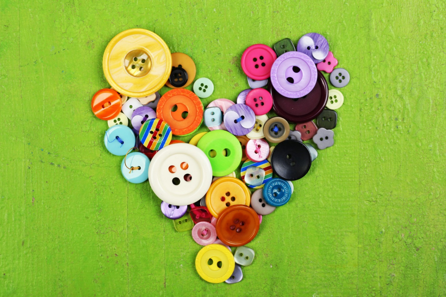 C:\Users\Dell\Downloads\sewing-buttons-heart-wooden-background.jpg